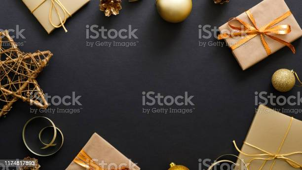 Christmas banner black xmas background with golden decorations gifts picture id1174817893?b=1&k=6&m=1174817893&s=612x612&h=vurtkuznj1sxohj5iuh5pl77qu2palhhwhj6cgmwrnq=