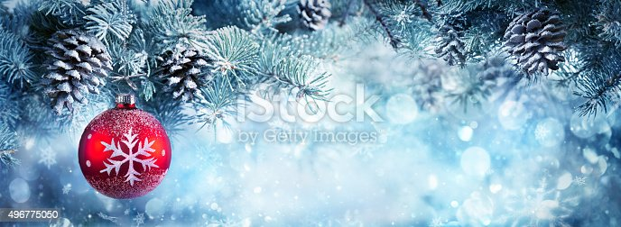 istock Christmas Banner - Fir Branch And Red Bauble 496775050