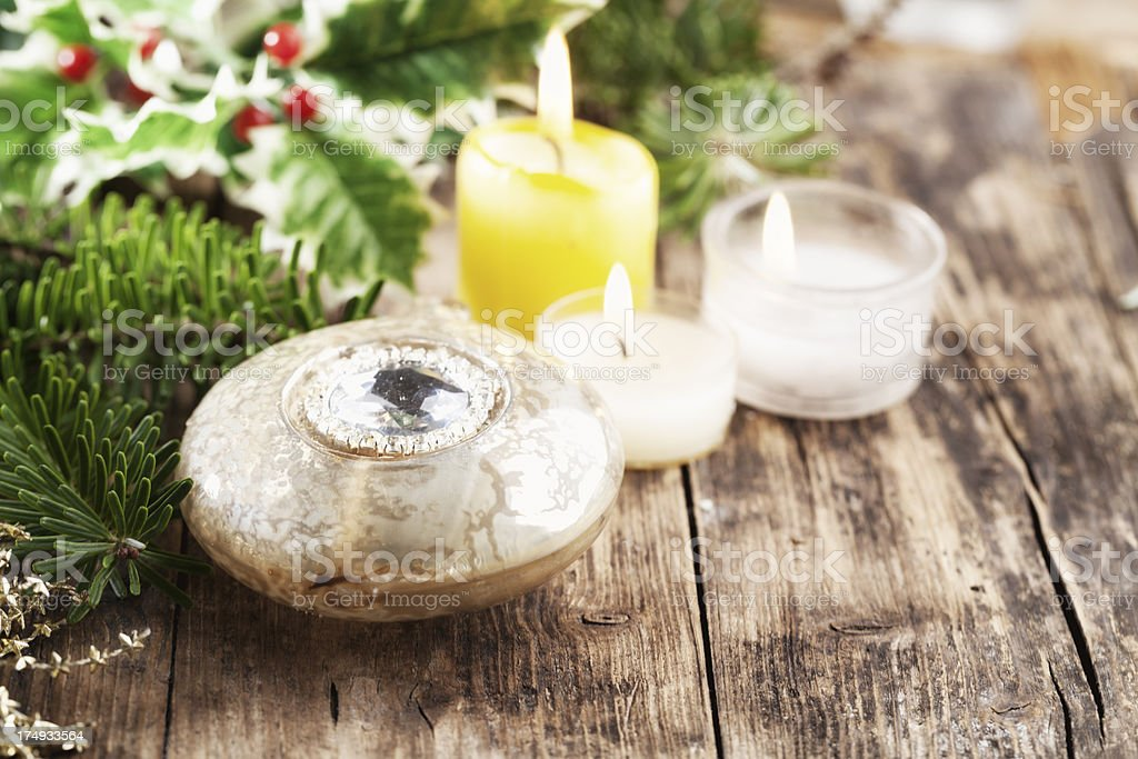 christmas bauble fir branch and candles on wood royalty-free stock photo