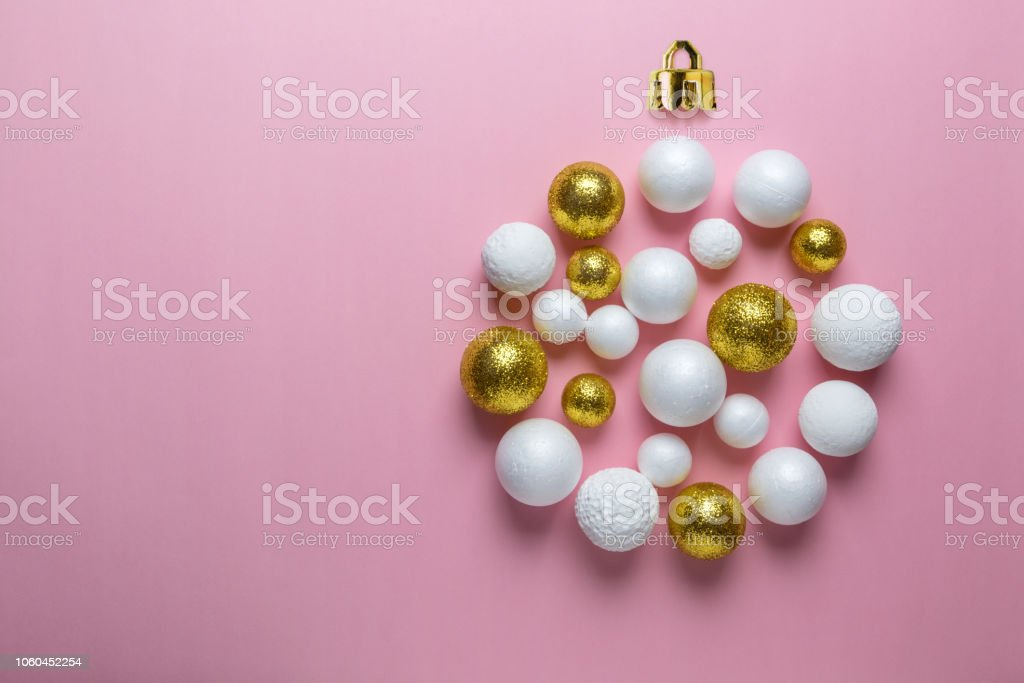 Christmas bauble made of gold and white glitter balls. Minimal New...