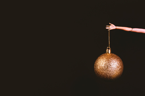 Christmas bauble on brown background
