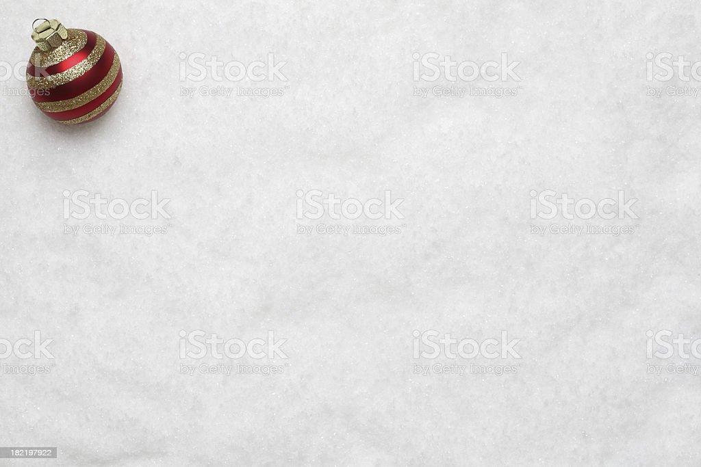 Christmas bauble on snow stock photo