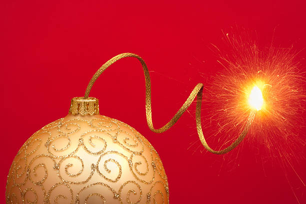 Christmas bauble with gold touch paper stock photo