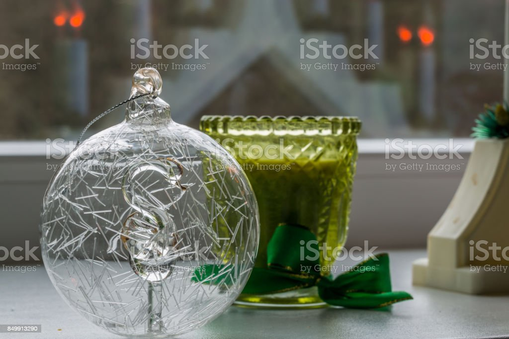 Christmas Bauble with Swan Figure Inside And Candle stock photo