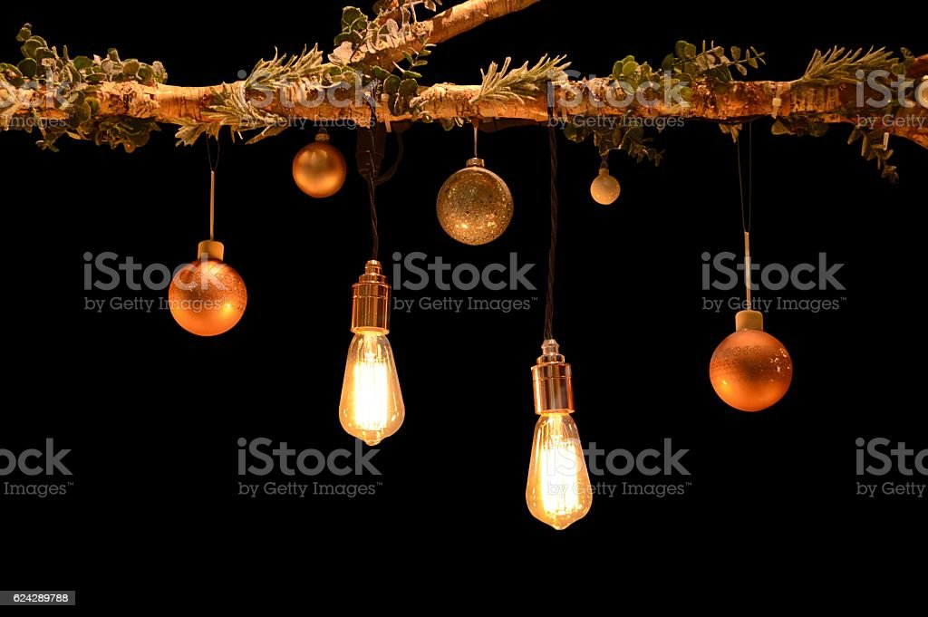 Christmas Baubles and lights hanging on a tree stock photo