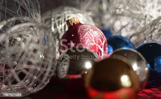 889246424 istock photo Christmas baubles and snowballs 1067521084