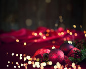 Christmas holiday elegant baubles and ribbon against a defocused Christmas lights background