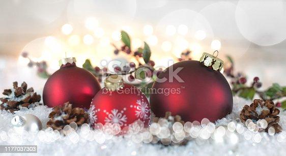 1020742072istockphoto Christmas Baubles Background 1177037303