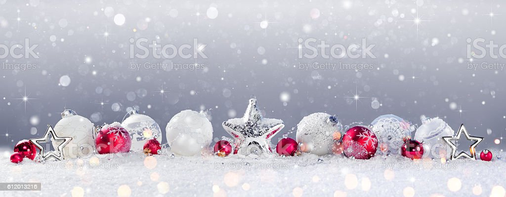 Christmas Baubles Decoration And Snowfall On Snow stock photo
