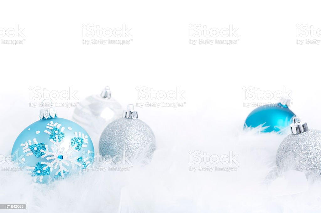Christmas baubles on a feathery surface, brightly lit royalty-free stock photo