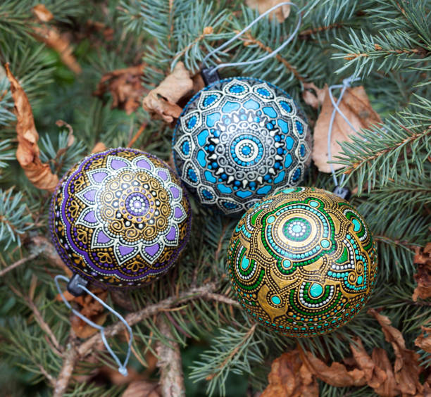 Christmas baubles with exclusive asian tribal ornament stock photo