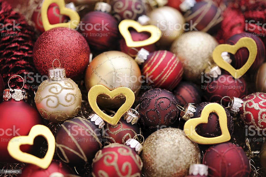 Christmas baubles with golden heart shapes royalty-free stock photo