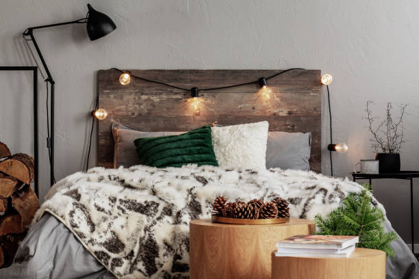 Christmas bedroom design with lights, spruce and cones Christmas bedroom design with lights, spruce and cones christmas interior stock pictures, royalty-free photos & images