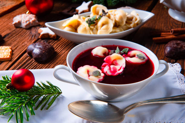 Christmas beetroot soup- borscht with small dumplings Christmas beetroot soup- borscht with small dumplingsChristmas beetroot soup- borscht with small dumplings polish culture stock pictures, royalty-free photos & images