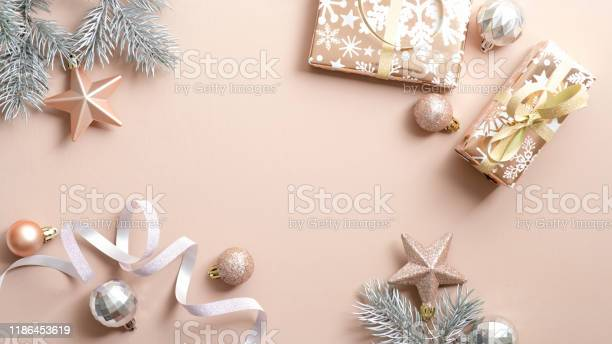 Christmas beige background with gift boxes pine tree branches ribbon picture id1186453619?b=1&k=6&m=1186453619&s=612x612&h=valt6fabfbj1dj9skbkxgirntbqncnfl9xnfzth7z2q=