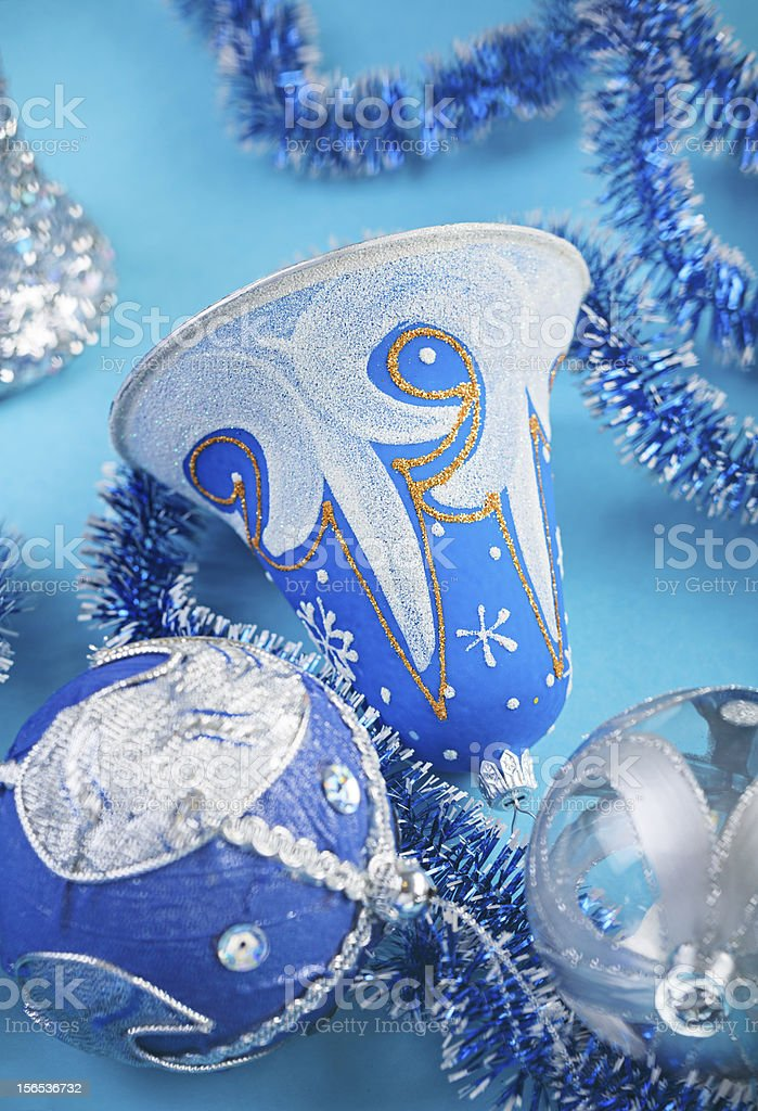 Christmas bell and decorations on blue background royalty-free stock photo