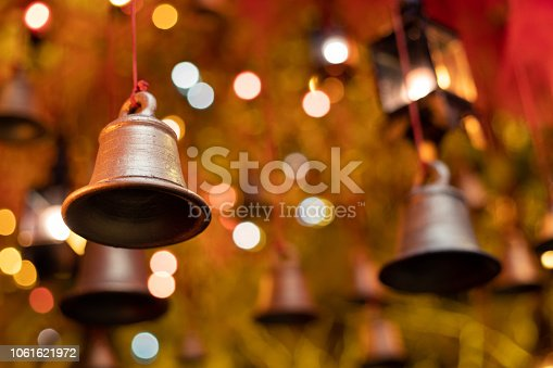 Hanging bells with background light and bokeh lighting used in Christmas , diwali and chinese new year.