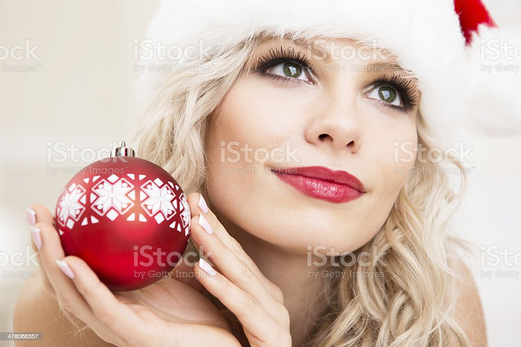 Christmas- Blonde woman holding bauble stock photo