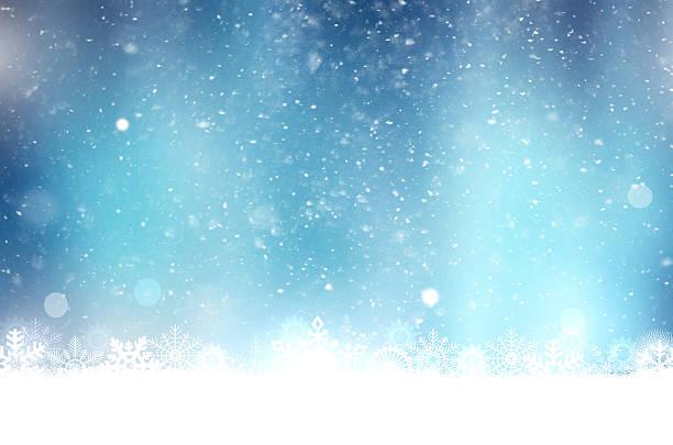 weihnachten blauer hintergrund mit schnee flocken - es schneit text stock-fotos und bilder