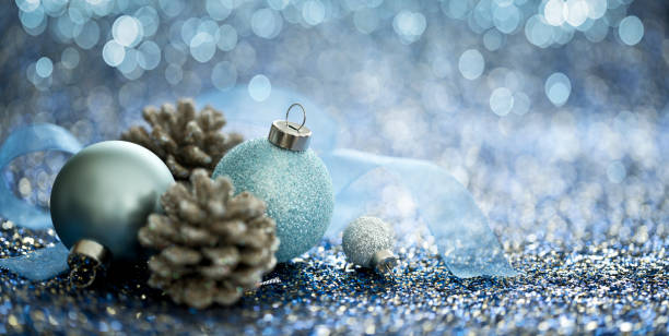 Christmas Blue Baubles on a Blue Background stock photo