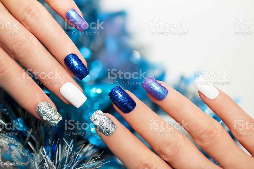 Christmas blue manicure. stock photo