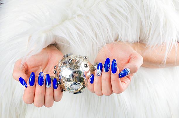 Christmas blue nails stock photo