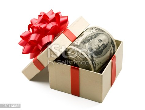 A roll of hundred dollar bills laying in a gift box that is decorated with red bow.