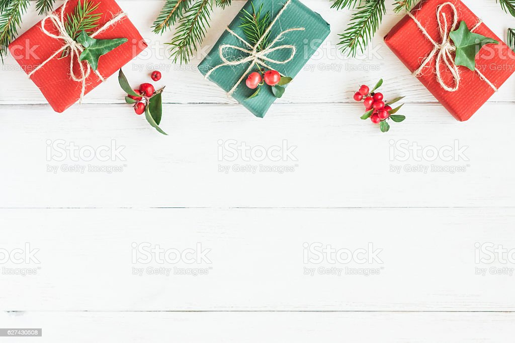 Christmas border. Christmas gifts, fir branches. Flat lay, top view stock photo