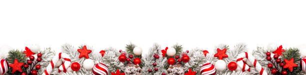 Christmas border of red and white ornaments and frosty branches isolated on white stock photo