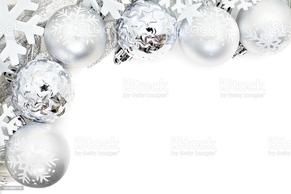 Christmas border of snowflakes and silver baubles stock photo