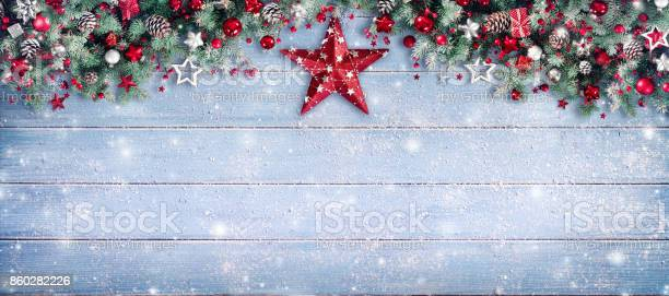 Christmas border pine branches and red star on wooden picture id860282226?b=1&k=6&m=860282226&s=612x612&h=p mslql5ugjvmel9hwlzyq6scbz yfatd9tcggwhpvi=