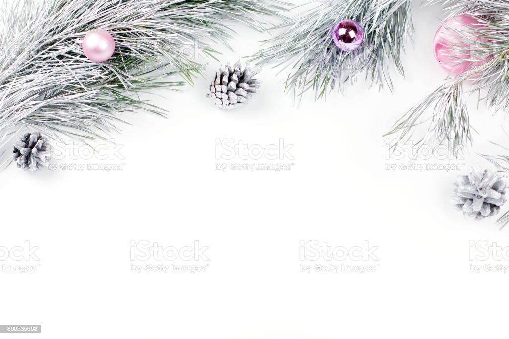 Christmas border with fir branches, presents, christmas ornaments on white background