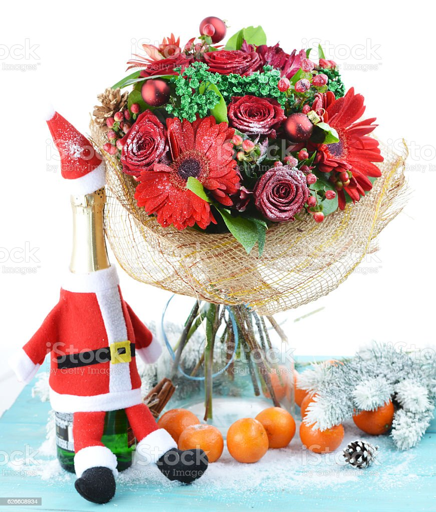 Christmas Bouquet Of Fresh Flowers And Fruit And A Bottle Stock