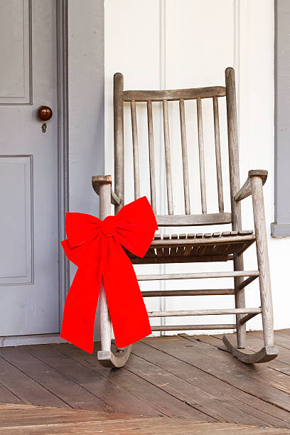 Remarkable Christmas Bow On Rural Rocking Chair Stock Photo Download Ibusinesslaw Wood Chair Design Ideas Ibusinesslaworg