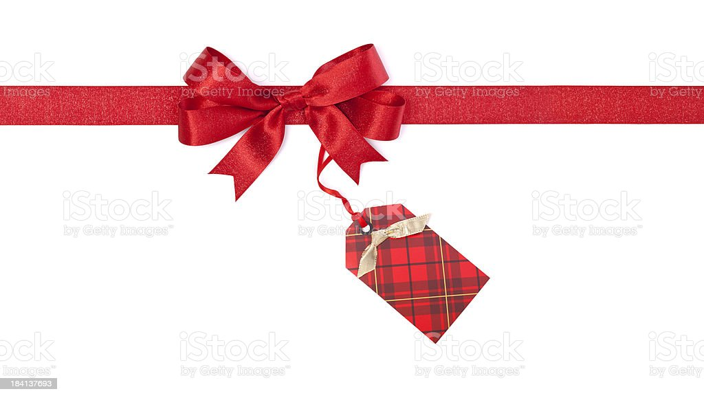 Christmas Bow With Red Plaid Tag stock photo