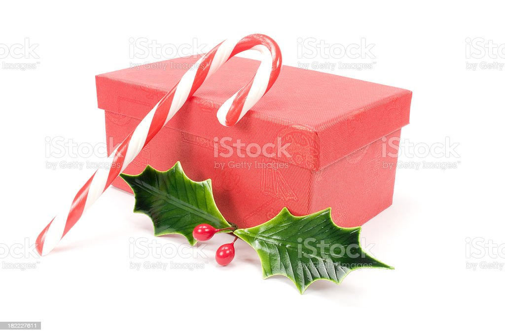 christmas box with candy cane and holly royalty-free stock photo