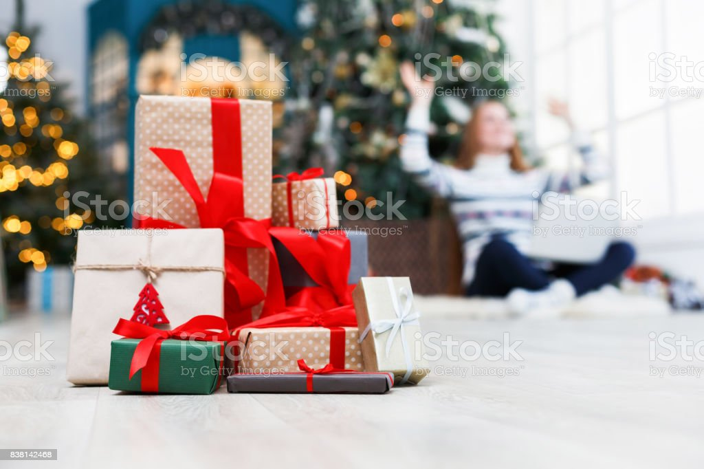 Winter holidays background. Christmas gift boxes band with red...