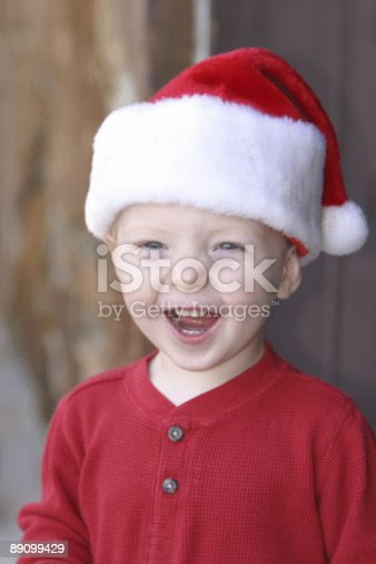 Christmas presents delivery. Cute baby elf sitting with lots of gift boxes, free space