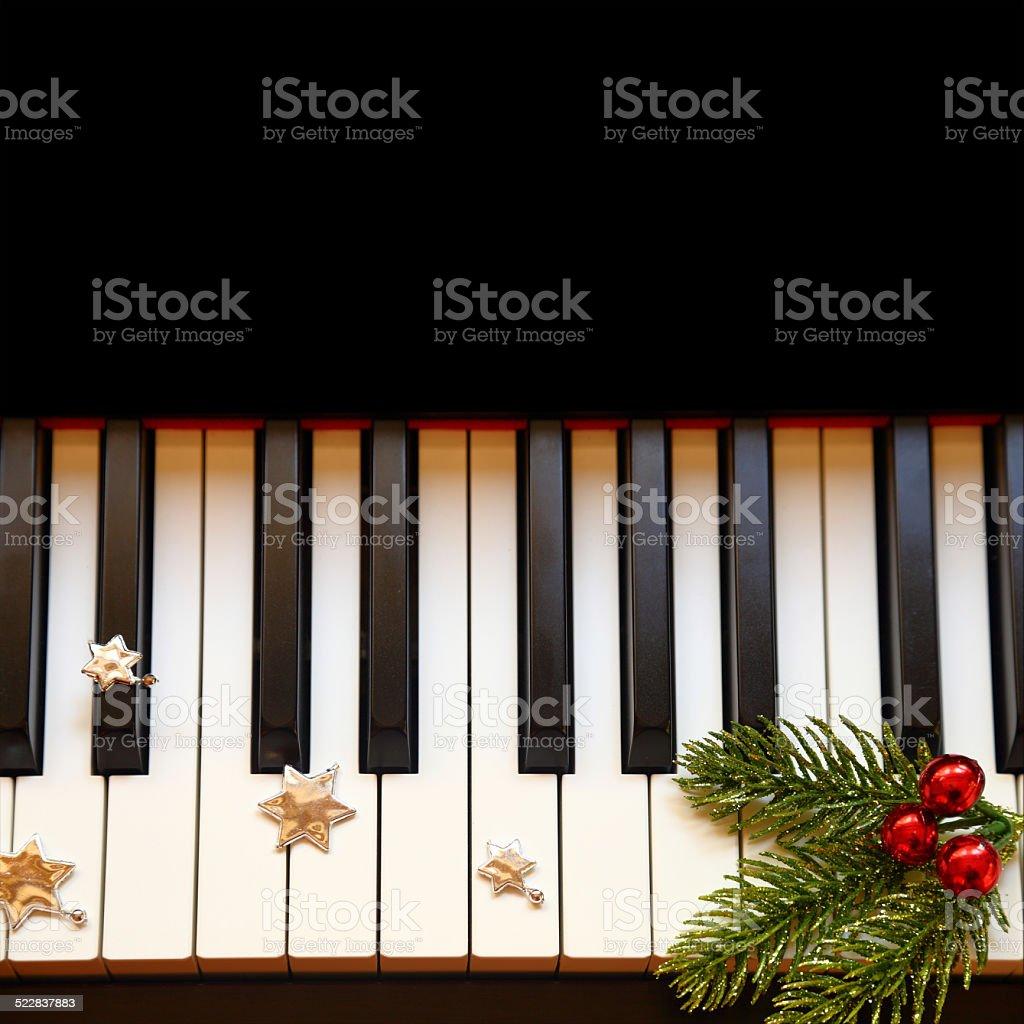 Christmas branch on piano keys stock photo