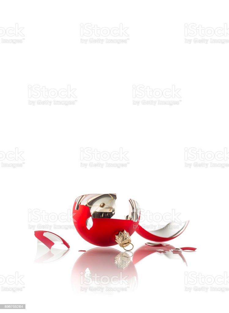 Christmas. Broken red christmas ball isolated on white stock photo