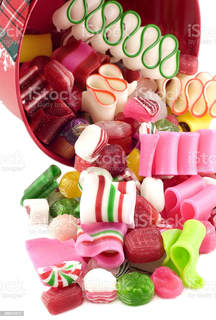 Christmas Bucket with Candy Spilling Out royalty-free stock photo