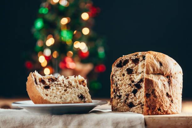 christmas cake panettone and christmas decorations. - panettone foto e immagini stock