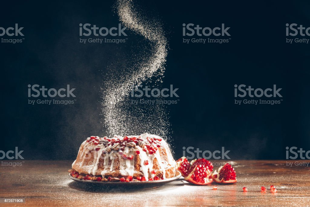 christmas cake powdering with icing sugar stock photo