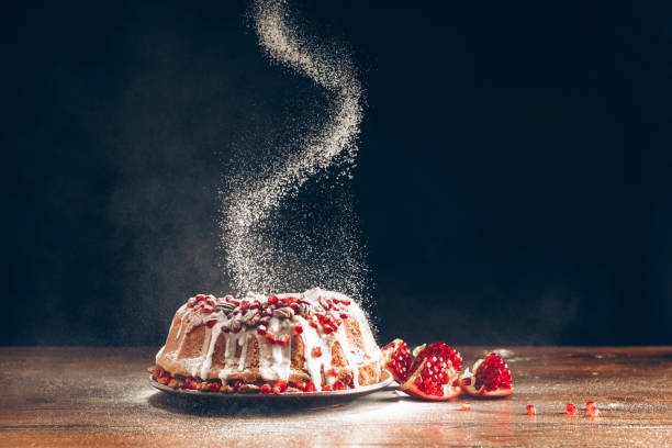 christmas cake powdering with icing sugar - vacations food stock pictures, royalty-free photos & images
