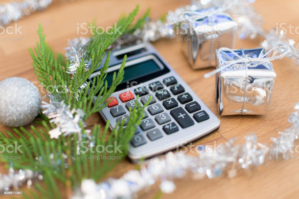 Christmas Calculator On A Desk With Decorations Stock Photo