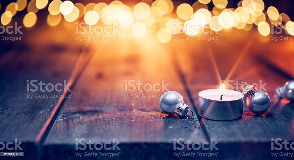 Christmas candle and ornaments on  table - Defocused Blue wood stock photo