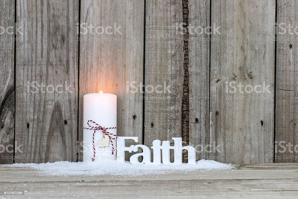 Christmas candle and the word Faith stock photo