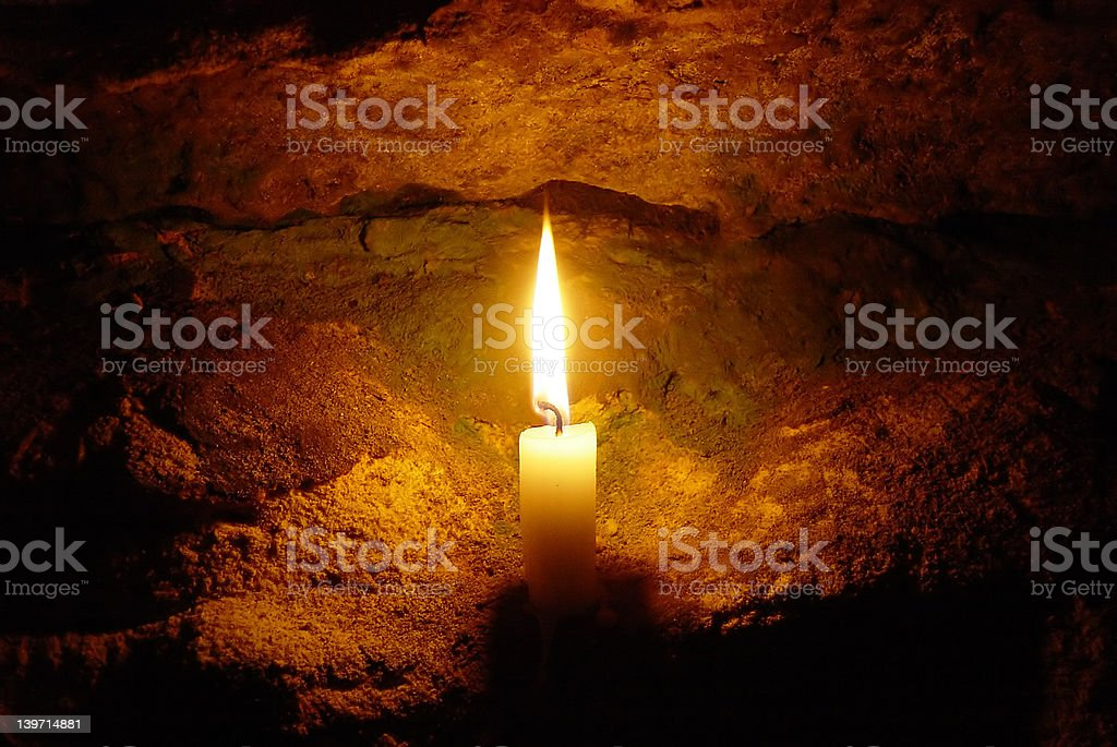 christmas candle in a cave royalty-free stock photo