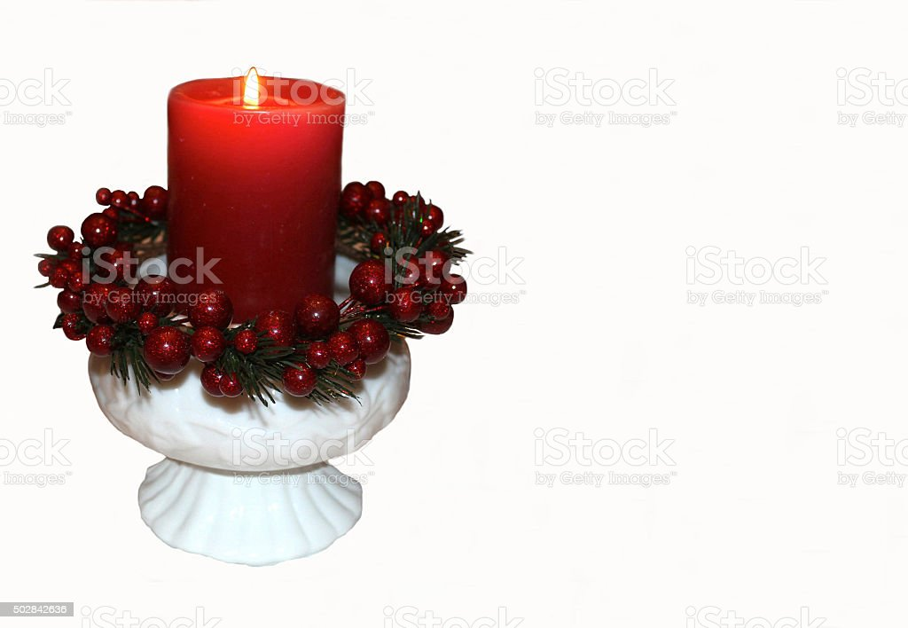 Christmas Candle in White Fenton and Milk Glass Candleholders stock photo