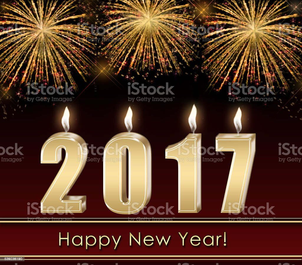 Christmas candle on the background of New Year's fireworks royalty-free stock photo